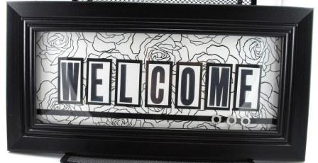 handstamped welcome sign